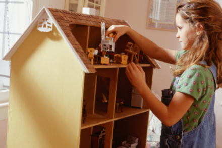 Playing with a doll house is a childhood must