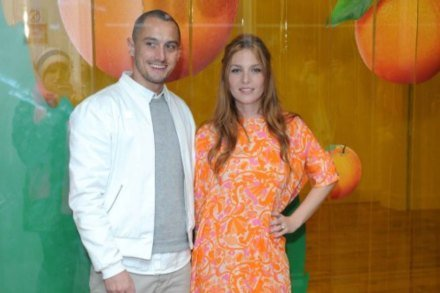 Richard Nicoll and Josephine De La Baume wearing the dress he designed