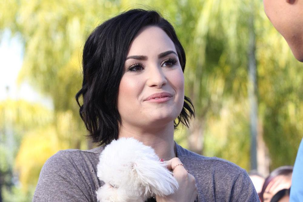 Demi Lovato with Buddy