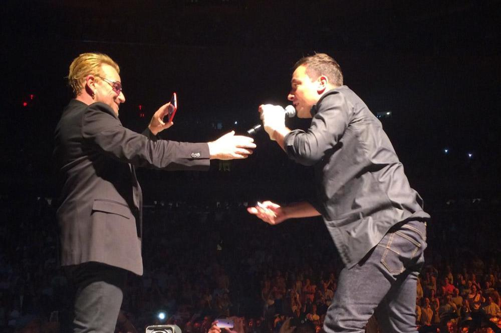 Jimmy Fallon on stage with Bono