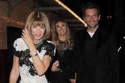 Bradley Cooper and Suki Waterhouse with Anna Wintour
