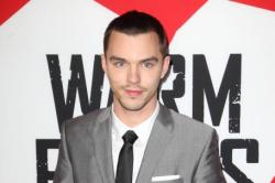 Nicholas Hoult looked dapper in a grey suit