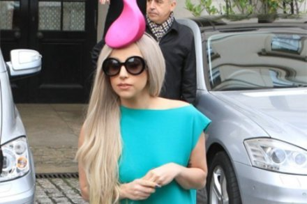 Lady Gaga wearing a pink hat resembling a sperm cell