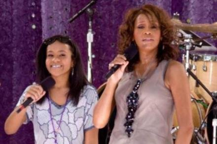 Bobbi Kristina on stage with her mother Whitney Houston before her death
