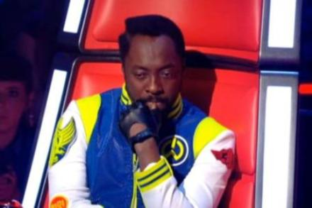 Will.i.am has been caught using his phone during the programme