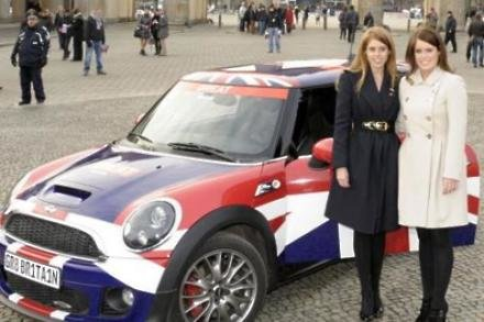 Princesses Beatrice and Eugenie with their Mini