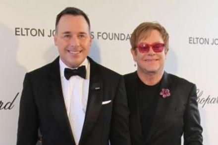 Sir Elton John and David Furnish at Oscars party