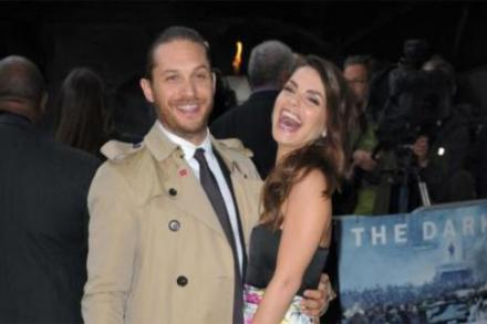 Tom Hardy wears a trench coat to the Dark Knight Rises premiere in London