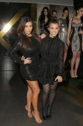 Kim and Kourtney Kardashian at the launch of the Kardashian Kollection