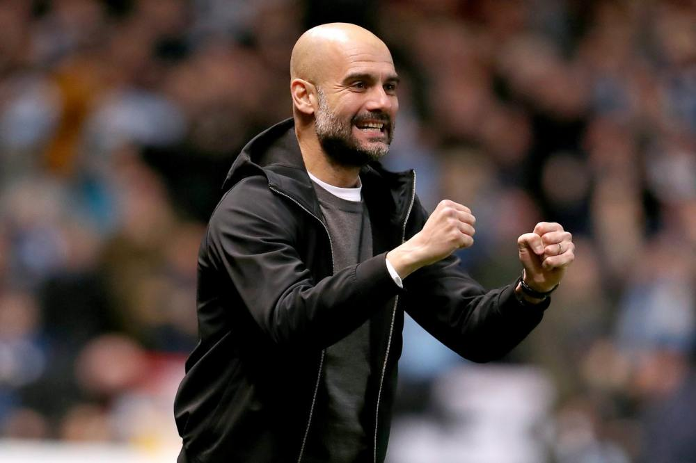 Guardiola hits back at Neville