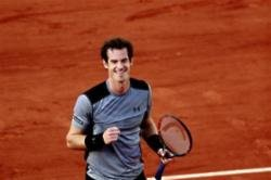 Murray through after Tomic withdrawal