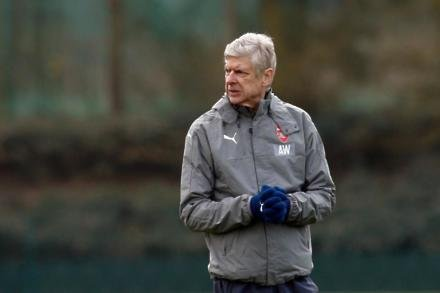 Job done for Wenger as Arsenal top group