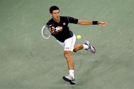 Djokovic happy to go through
