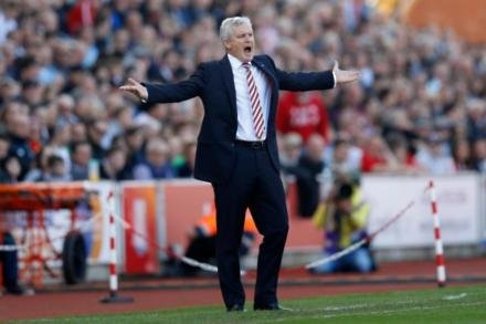 Hughes unimpressed with ref